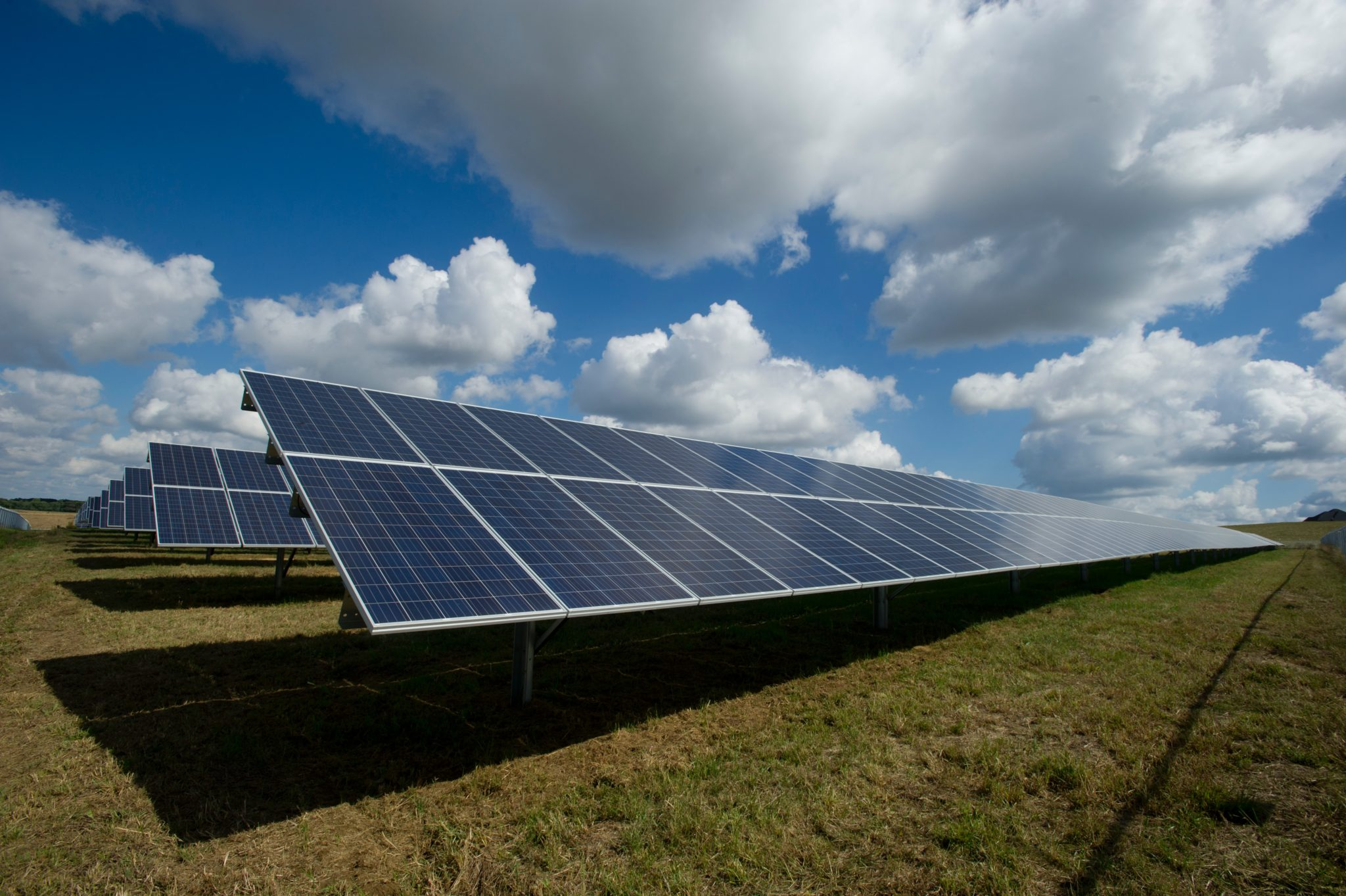 Clouds gather over solar panels thumbnail